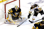 Pittsburgh Penguins goaltender Matt Murray (30) stops a shot during the first period of an NHL hockey game with Boston Bruins' Lee Stempniak (18) looking for the rebound in Pittsburgh, Sunday, March 10, 2019. (AP Photo/Gene J. Puskar)