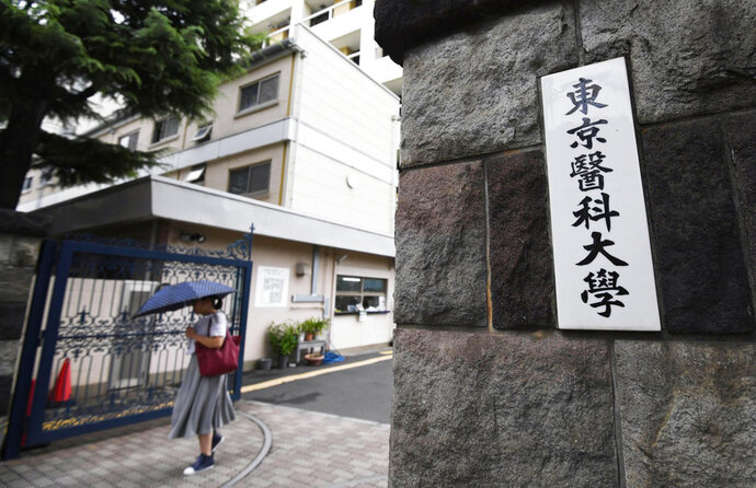 This Aug. 7, 2018, photo shows an entrance at the Tokyo Medical University in Tokyo. The Education Ministry sent a questionnaire Friday, Aug. 10 to all of Japan's medical schools asking them for six years of data on the gender and age of those who applied, of those who passed the entrance exam and of those who were admitted. (Akiko Matsushita/Kyodo News via AP)