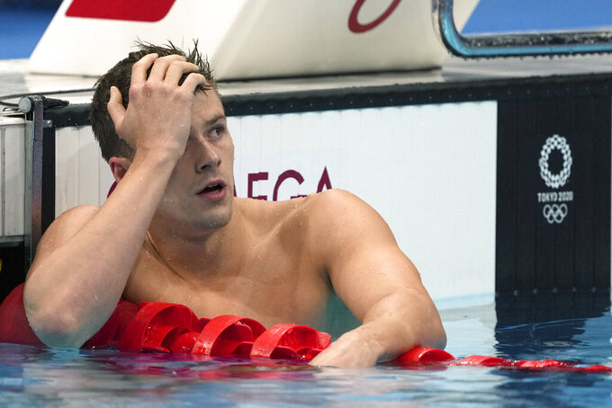 Nic Fink of the United States rests after his swim in the men's 200-meter breaststroke final at the 2020 Summer Olympics, Thursday, July 29, 2021, in Tokyo, Japan. (AP Photo/Matthias Schrader)