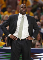 Indiana Pacers head coach Nate McMillan yells to his team as they played against the Boston Celtics during the first half of Game 4 of an NBA basketball first-round playoff series in Indianapolis, Sunday, April 21, 2019. (AP Photo/Michael Conroy)