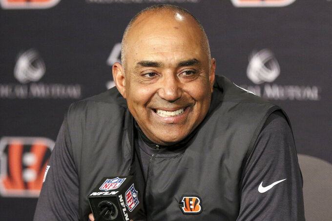 FILE - In this Sunday, Dec. 16, 2018 file photo, Cincinnati Bengals head coach Marvin Lewis attends a new conference after an NFL football game against the Oakland Raiders in Cincinnati. The Dallas Cowboys are talking to former head coaches Mike McCarthy and Marvin Lewis in the surest sign so far that they are moving on from Jason Garrett. Lewis spent time with the Cowboys on Friday and Saturday, Jan. 4, 2020 one of the people said.(AP Photo/Gary Landers, File)