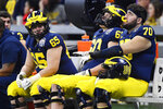 Michigan players sit on the bench in the closing seconds of the Peach Bowl NCAA college football game against Florida, Saturday, Dec. 29, 2018, in Atlanta. Florida won 41-15. (AP Photo/Mike Stewart)