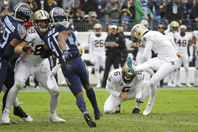 New Orleans Saints kicker Wil Lutz, right, kicks a 47-yard field goal against the Tennessee Titans in the first half of an NFL football game Sunday, Dec. 22, 2019, in Nashville, Tenn. Holding is Thomas Morstead (6). (AP Photo/James Kenney)