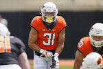 FILE - In this April 24, 2021, file photo, Oklahoma State safety Kolby Harvell-Peel gets set during an intrasquad scrimmage at NCAA college football game in Stillwater, Okla. (AP Photo/Sue Ogrocki, File)