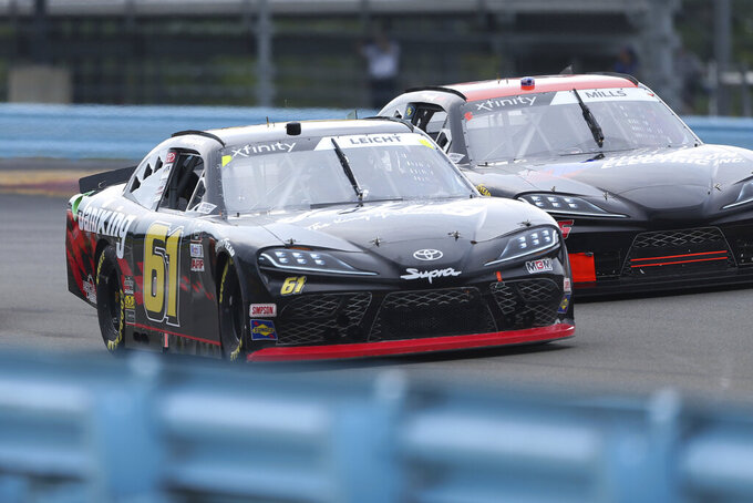 Stephen Leicht (61) and Matt Mills drive between Turn 1 and the Esses in the NASCAR Xfinity Series auto race at Watkins Glen International in Watkins Glen, N.Y., on Saturday, Aug. 7, 2021. (AP Photo/Joshua Bessex)