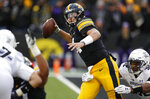 Iowa quarterback Nate Stanley, center, passes as he is pressured by Northwestern linebacker Nate Hall (32) during the first half of an NCAA college football game, Saturday, Nov. 10, 2018, in Iowa City, Iowa. (AP Photo/Charlie Neibergall)