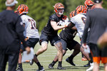 Cincinnati Bengals defensive end Sam Hubbard, center, participates in the NFL football team's rookie minicamp, Friday, May 11, 2018, in Cincinnati. Hubbard was playing dodgeball when Ohio State coach Urban Meyer first noticed him. He wound up playing defensive end for the Buckeyes and now he will be suiting up for his hometown Bengals. (AP Photo/John Minchillo)