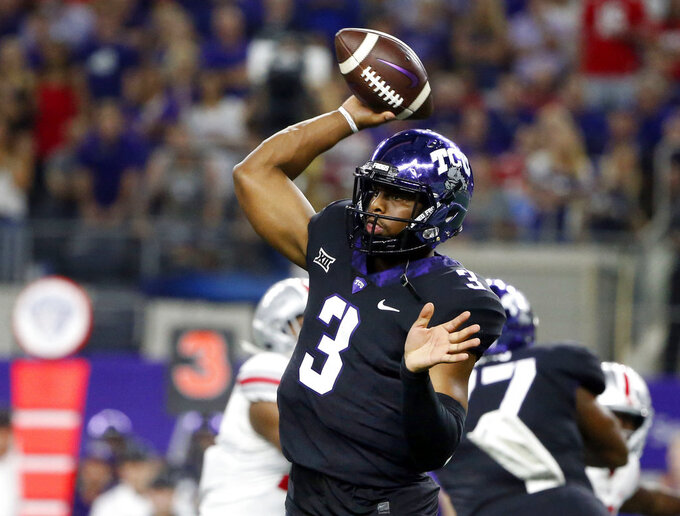 FILE - In this Saturday, Sept. 15, 2018, file photo, TCU quarterback Shawn Robinson (3) throws against Ohio State during the first half of an NCAA college football game in Arlington, Texas. TCU coach Gary Patterson promised this week that Robinson will play against Texas Tech, despite the fact he was helped off the field and to the locker room in the final minute against Iowa State after taking a direct hit to his left (non-throwing) shoulder. (AP Photo/Michael Ainsworth, File)