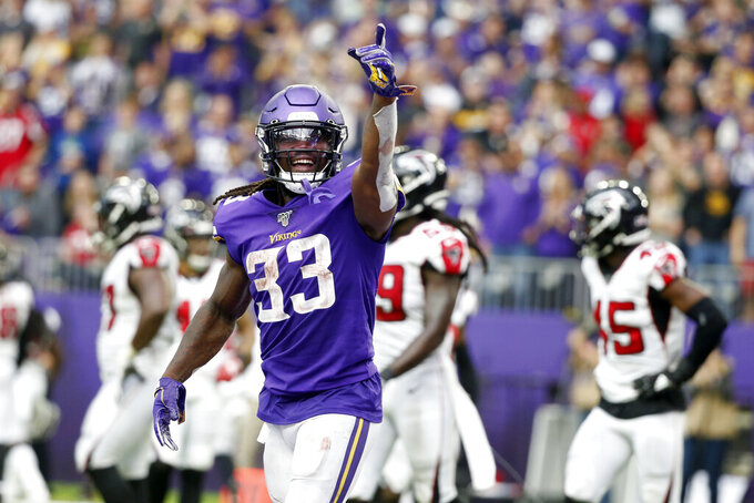 Vikings trample Falcons 28-12 behind fierce defense, Cook