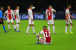 Ajax players with Hakim Ziyech, front, react to their elimination from the Champions League after losing the group H soccer match between Ajax and Valencia at the Johan Cruyff ArenA in Amsterdam, Netherlands, Tuesday, Dec. 10, 2019. (AP Photo/Peter Dejong)