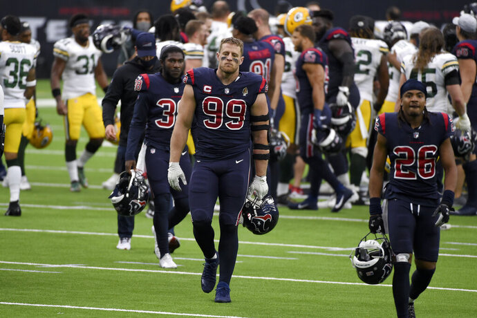 Houston Texans defensive end J.J. Watt (99) walks off the field following an NFL football game against the Green Bay Packers Sunday, Oct. 25, 2020, in Houston. (AP Photo/Eric Christian Smith)