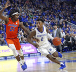 Kentucky's Ashton Hagans (2) drives while defended by Florida's Dontay Bassett (21) during the first half of an NCAA college basketball game in Lexington, Ky., Saturday, March 9, 2019. (AP Photo/James Crisp)