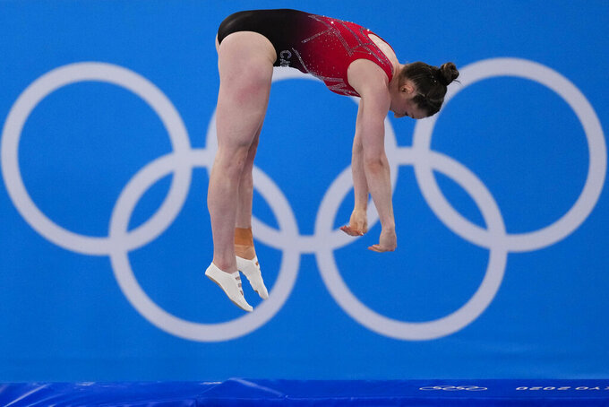Rosannagh Maclennan, of Canada, competes in the women's trampoline gymnastics qualifiers at the 2020 Summer Olympics, Friday, July 30, 2021, in Tokyo. (AP Photo/Ashley Landis)
