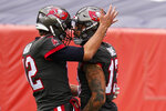Tampa Bay Buccaneers wide receiver Mike Evans, right, celebrates with quarterback Tom Brady, left, after scoring a touchdown during the first half of an NFL football game against the Denver Broncos, Sunday, Sept. 27, 2020, in Denver. (AP Photo/David Zalubowski)