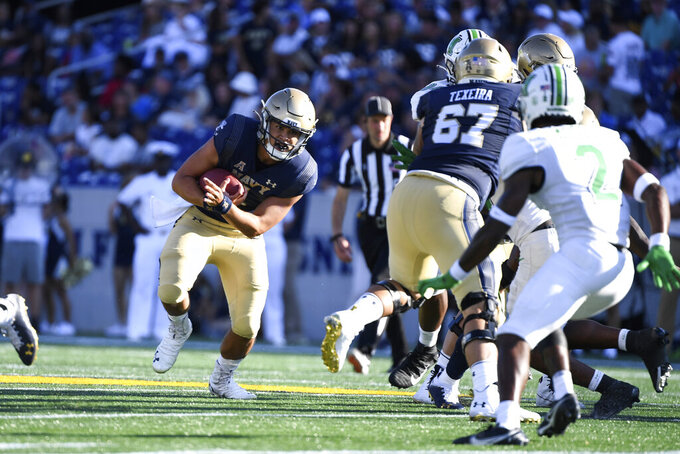 Navy quarterback Tai Lavatai runs the ball during the second half of an NCAA college football game against Marshall, Saturday, Sept. 4, 2021, Annapolis, Md. (AP Photo/Terrance Williams)