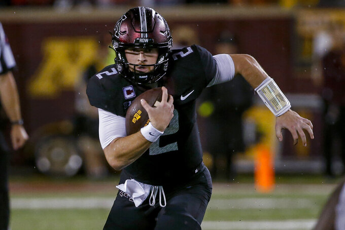 Minnesota quarterback Tanner Morgan carries against Ohio State during the fourth quarter of an NCAA college football game Thursday, Sept. 2, 2021, in Minneapolis. Ohio State won 45-31. (AP Photo/Bruce Kluckhohn)