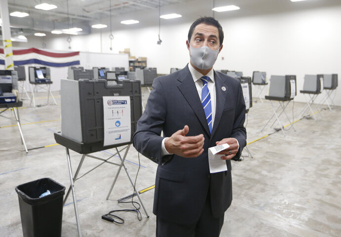 Ohio Secretary of State Frank LaRose speaks during a media tour of the Delaware County Board of Elections in Delaware, Ohio, Sunday, Nov. 1, 2020. (AP Photo/Paul Vernon)