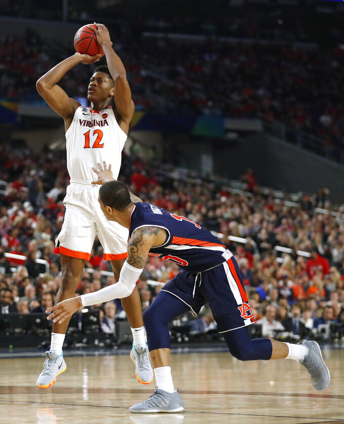 Virginia guard De'Andre Hunter (12) shoots over Auburn guard Samir Doughty during the first half in the semifinals of the Final Four NCAA college basketball tournament, Saturday, April 6, 2019, in Minneapolis. (AP Photo/Jeff Roberson)