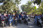 Indian students ride on motor bikes shouting slogans as they enforce a shutdown strike to protest against the Citizenship Amendment Bill (CAB) in Gauhati, India, Tuesday, Dec. 10, 2019. Opponents of legislation that would grant Indian citizenship to non-Muslim illegal migrants from Pakistan, Bangladesh and Afghanistan have enforced an 11-hour shutdown across India's northeastern region. (AP Photo/Anupam Nath)