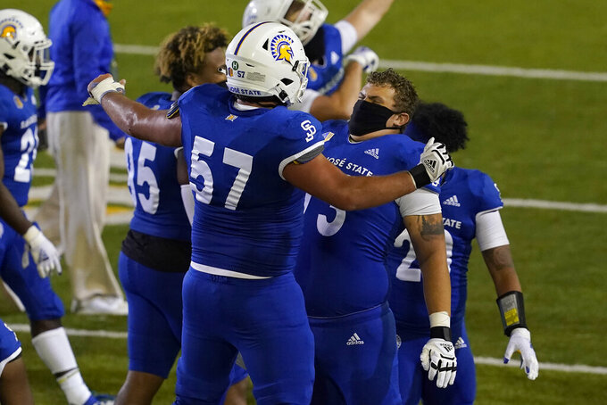 San Jose State's Trevor Robbins (57) celebrates with John Weiss after San Jose State defeated Air Force in an NCAA college football game in San Jose, Calif., Saturday, Oct. 24, 2020. (AP Photo/Jeff Chiu)
