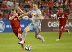 New York Red Bulls' Tim Parker (26) and Toronto FC's Jacob Shaffelburg (24) vie for control of the ball during the second half of an MLS soccer match Wednesday, July 17, 2019, in Toronto. (Nathan Denette/The Canadian Press via AP)