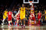 Southern California guard Elijah Weaver celebrates his 3-point basket during the second half of the team's NCAA college basketball game against Utah on Thursday, Jan. 30, 2020 in Los Angeles. (AP Photo/Kyusung Gong)