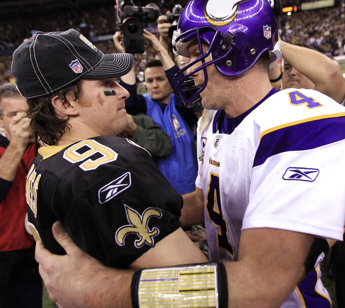 FILE - In this Jan. 24, 2010, file photo, Minnesota Vikings quarterback Brett Favre (4) congratulates New Orleans Saints quarterback Drew Brees (9) after overtime in the NFC Championship NFL football game in New Orleans. The Saints defeated the Vikings 31-28 to advance to the Super Bowl against the Indianapolis Colts. Brees is one of just two current Saints players who played in the NFC title game against the Vikings in January 2010. (AP Photo/David J. Phillip, File)