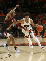 Oregon State's Stephen Thompson Jr. (1) drives past Stanford's Bryce Wills during the first half of an NCAA college basketball game in Corvallis, Ore., Thursday, Feb. 7, 2019. (AP Photo/Amanda Loman)