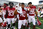 Arkansas players Kelin Burrle (33), Chris Harris (83) and Kevin Compton (26) celebrate the Razorbacks' 38-17 win over Rice in an NCAA college football game Saturday, Sept. 4, 2021, in Fayetteville, Ark. (AP Photo/Michael Woods)