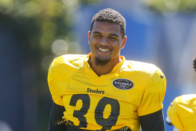 Pittsburgh Steelers newly acquired safety Minkah Fitzpatrick smiles as he warms up during an NFL football practice, Wednesday, Sept. 18, 2019, in Pittsburgh. (AP Photo/Keith Srakocic)