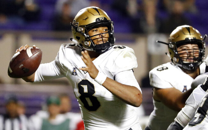 FILE - In this Oct. 20, 2018, file photo, Central Florida's Darriel Mack Jr. (8) prepares to throw the ball during the second half of an NCAA college football game against East Carolina, in Greenville, N.C. The seventh-ranked Knights (11-0, 8-0, No. 8 CFP) are one victory away from their second straight American Athletic Conference championship, a likely New Year's Six bowl bid and bolstering their argument that they are deserving of consideration for a berth in the College Football Playoff. None of that is possible, though, without beating Memphis (8-4, 5-3) in Saturday's AAC title game. Red-shirt freshman Darriel Mack Jr. will be playing for injured two-time AAC offensive player of the year McKenzie Milton. (AP Photo/Karl B DeBlaker, File)