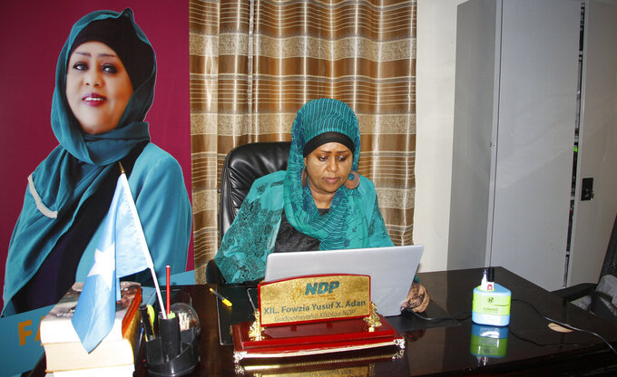 Somali Parliament member Fawzia Yusuf H. Adam sits in her office in Mogadishu, Somalia Saturday, July 17, 2021. The woman who broke barriers as the first female foreign minister and deputy prime minister in culturally conservative Somalia now aims for the country's top office as the country moves toward a long-delayed presidential election. (AP Photo/Farah Abdi Warsameh)