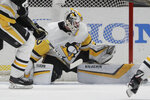 Pittsburgh Penguins goaltender Matt Murray blocks a shot during the first period of the team's NHL hockey game against the Anaheim Ducks in Anaheim, Calif., Friday, Jan. 11, 2019. (AP Photo/Chris Carlson)