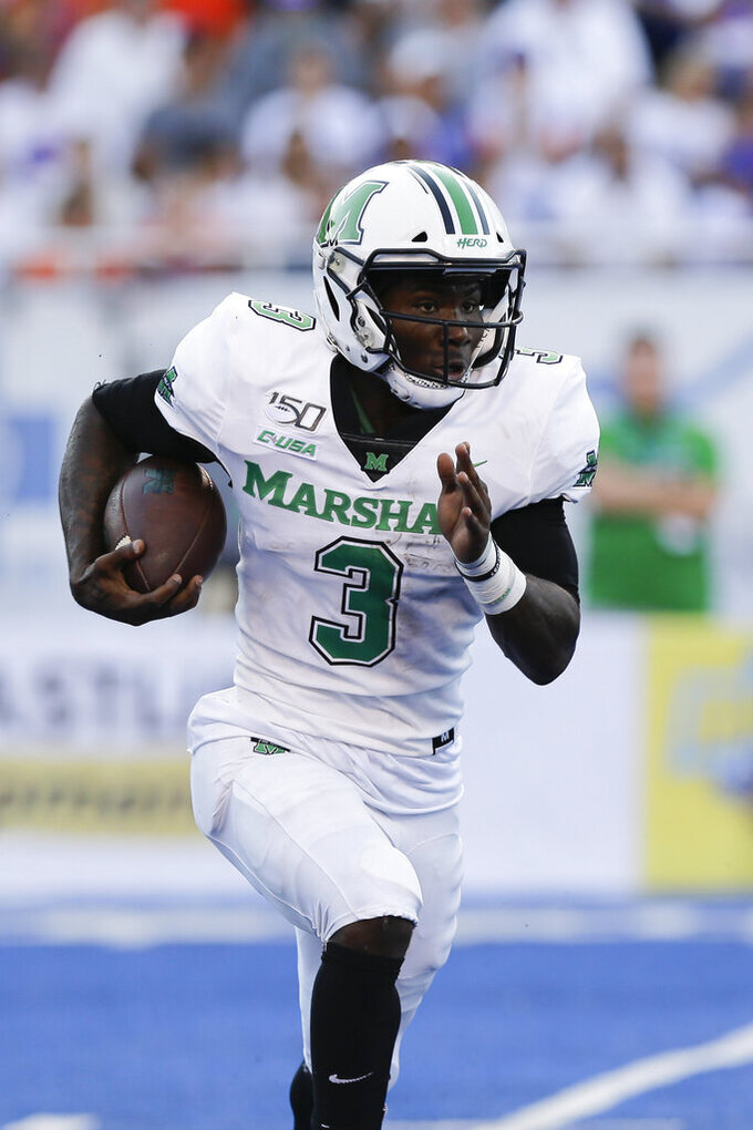 Marshall running back Tyler King (3) runs the ball during the first half of an NCAA college football game against Boise State in Boise, Idaho, Friday, Sept. 6, 2019. (AP Photo/Otto Kitsinger)