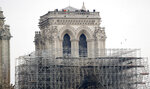 Firemen inspect the Notre Dame cathedral after the fire in Paris, Tuesday, April 16, 2019. Experts are assessing the blackened shell of Paris' iconic Notre Dame cathedral to establish next steps to save what remains after a devastating fire destroyed much of the almost 900-year-old building. With the fire that broke out Monday evening and quickly consumed the cathedral now under control, attention is turning to ensuring the structural integrity of the remaining building. (AP Photo/Christophe Ena)