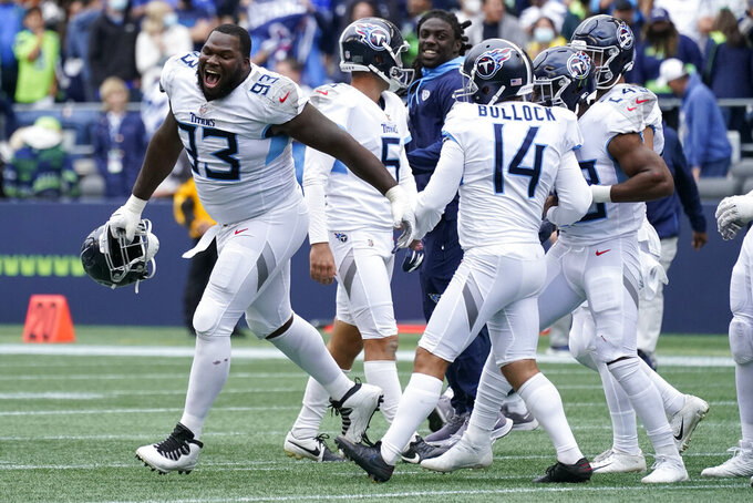 Tennessee Titans defensive tackle Teair Tart (93) reacts after kicker Randy Bullock (14) kicked a field goal in overtime to give the Titans a 33-30 win over the Seattle Seahawks in an NFL football game, Sunday, Sept. 19, 2021, in Seattle. (AP Photo/Elaine Thompson)