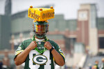 Packers' fan Bobby Anderson poses for a photo outside Lambeau Field during NFL football training camp Saturday, July 31, 2021, in Green Bay, Wis. (AP Photo/Matt Ludtke)