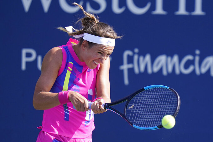 Victoria Azarenka, of Belarus, hits a shot to Ons Jabeur, of Tunisia, during the quarterfinals at the Western & Southern Open tennis tournament Wednesday, Aug. 26, 2020, in New York. (AP Photo/Frank Franklin II)