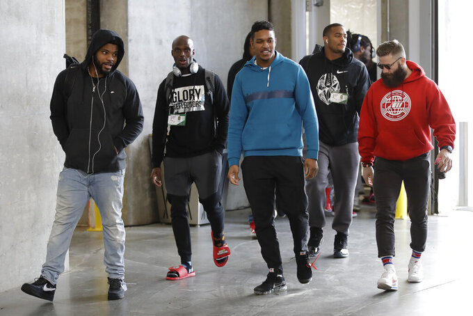 New England Patriots players arrive for a NFL football walkthrough, Saturday, Feb. 2, 2019, in Atlanta, ahead of Super Bowl 53 against the Los Angeles Rams. (AP Photo/Matt Rourke)