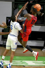 Dayton guard Jalen Crutcher (10) tries to shoot over Memphis guard Boogie Ellis (5) in the second half of an NCAA college basketball game in the first round of the NIT Tournament, Saturday, March 20, 2021, in Denton, Texas. Memphis won 71-60. (AP Photo/Matt Strasen)