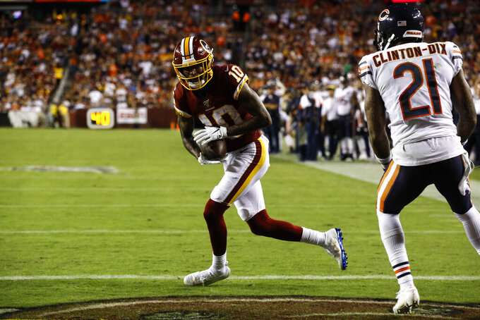 Washington Redskins wide receiver Paul Richardson (10) runs with his touchdown catch in front of Chicago Bears safety Ha Ha Clinton-Dix (21) during the second half of an NFL football game Monday, Sept. 23, 2019, in Landover, Md. (AP Photo/Patrick Semansky)