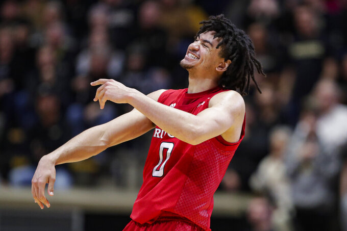 Rutgers guard Geo Baker (0) celebrates in the closing seconds of overtime in an NCAA college basketball game against Purdue in West Lafayette, Ind., Saturday, March 7, 2020. Rutgers defeated Purdue 71-68 in overtime. (AP Photo/Michael Conroy)