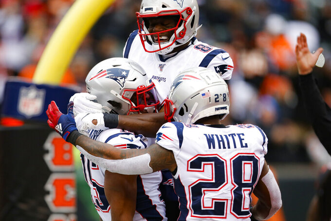 New England Patriots wide receiver N'Keal Harry, left, celebrates his touchdown in the second half of an NFL football game against the Cincinnati Bengals, Sunday, Dec. 15, 2019, in Cincinnati. (AP Photo/Gary Landers)