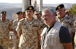 Jordan's King Abdullah II, second right, tours the Baqura enclave formerly leased by Israel with Crown Prince Hussein and military officers, Monday, Nov. 11, 2019. Jordan's decision not to renew the leases on the Baqura and Ghamr enclaves, known in Hebrew as Naharayim and Tzofar, were a fresh blow to Israel and Jordan's rocky relations 25 years after the two countries signed a peace deal. (Yousef Allan/Jordanian Royal Court via AP)