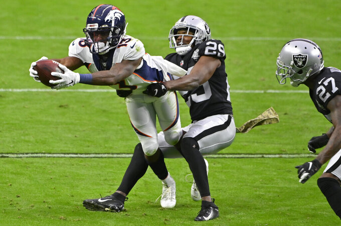 Las Vegas Raiders free safety Lamarcus Joyner (29) tackles Denver Broncos wide receiver K.J. Hamler (13) during the first half of an NFL football game, Sunday, Nov. 15, 2020, in Las Vegas. (AP Photo/David Becker)