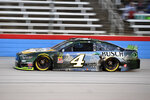 Kevin Harvick heads down the front stretch during qualifying for the NASCAR Cup Series auto race at Texas Motor Speedway in Fort Worth, Texas, Saturday, Nov. 2, 2019. Harvick earned the pole for Sunday's race. (AP Photo/Larry Papke)