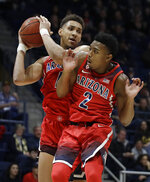 Arizona's Chase Jeter, left, pulls in a rebound next to Brandon Williams (2) during the first half of the team's NCAA college basketball game against California on Saturday, Jan. 12, 2019, in Berkeley, Calif. (AP Photo/Ben Margot)