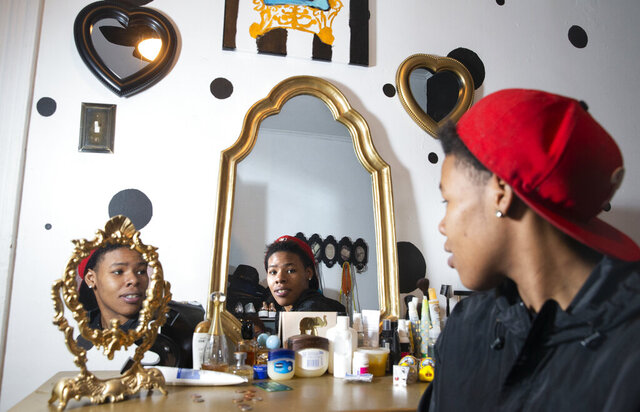 Malika Douglas, who once played basketball at Mastery North, was in and out of homeless shelters during her school years. Malika eventually moved in with Coach Damien Abrams and his family. She is shown in her old bedroom, now a dressing room, while visiting the Abrams home on Dec. 5, 2019. (Charles Fox/The Philadelphia Inquirer via AP)