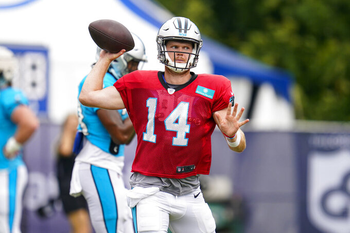 Carolina Panthers quarterback Sam Darnold throws during joint practice with the Indianapolis Colts at the NFL team's football training camp in Westfield, Ind., Thursday, Aug. 12, 2021. (AP Photo/Michael Conroy)