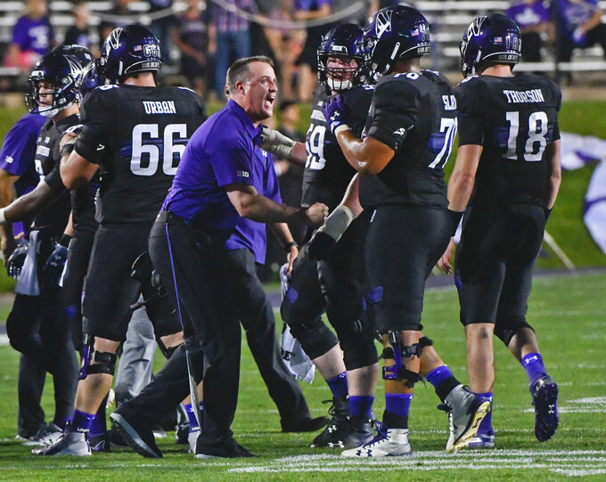FILE- In this Sept. 15, 2018, file photo Northwestern head coach Pat Fitzgerald directs his team against Akron during the first half of an NCAA college football game in Evanston, Ill. Nebraska plays Northwestern on Saturday, Oct. 13, (AP Photo/Matt Marton, File)